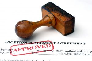 adoption placement agreement document with a large approved stamp, thanks to an adoption attorney