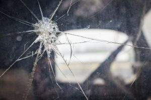 Large crack in a windshield or car window after an auto accident