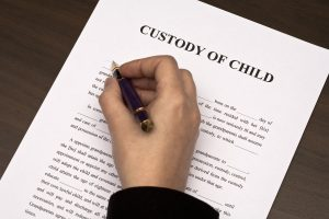 child custody agreement being filled out