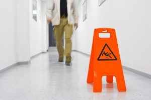 sign warning against slipping on slippery floor in an attempt to reduce premises liability