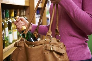woman shoplifting a bottle of wine. a misdemeanor in south carolina.